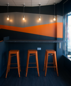 orange stools in cafe